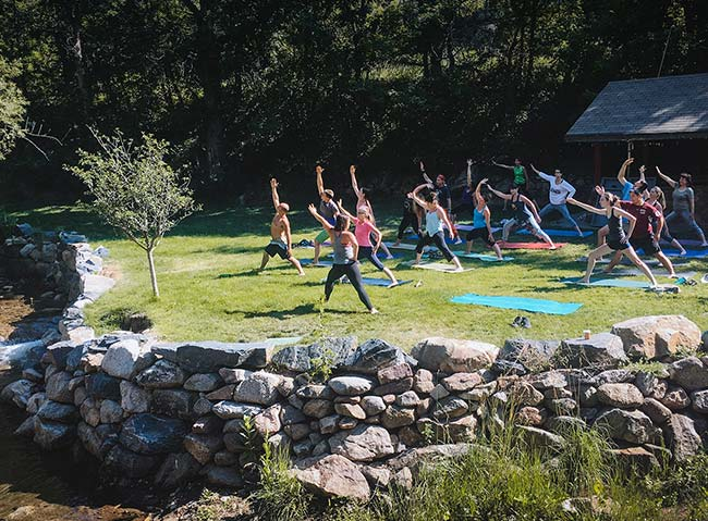 Outdoor group yoga at A-Lodge in Boulder, Colorado